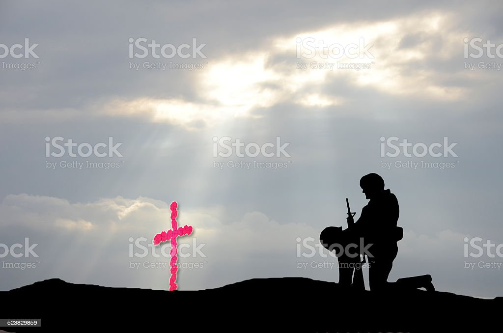 Veterans' Day Cross and Soldier stock photo