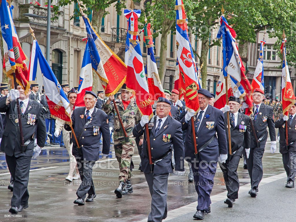 Veterans marching in the annual Bastille Day parade, Lille stock photo