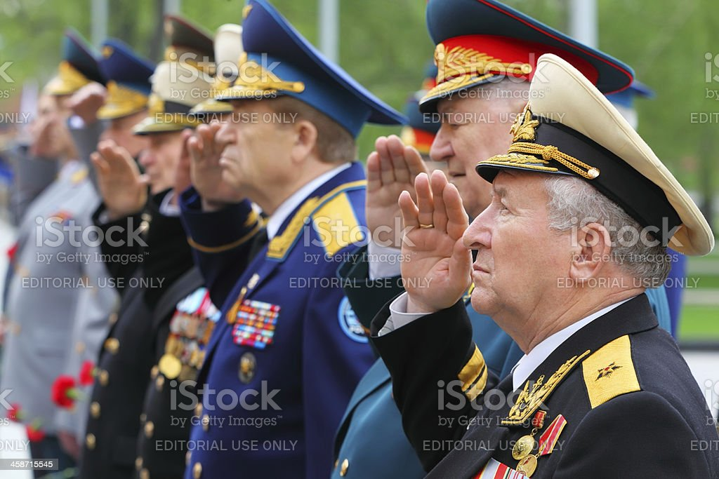 Veterans salute at ceremony of wreath laying royalty-free stock photo