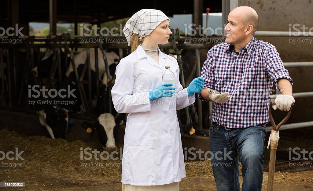 Veterinarian talking to farmer stock photo