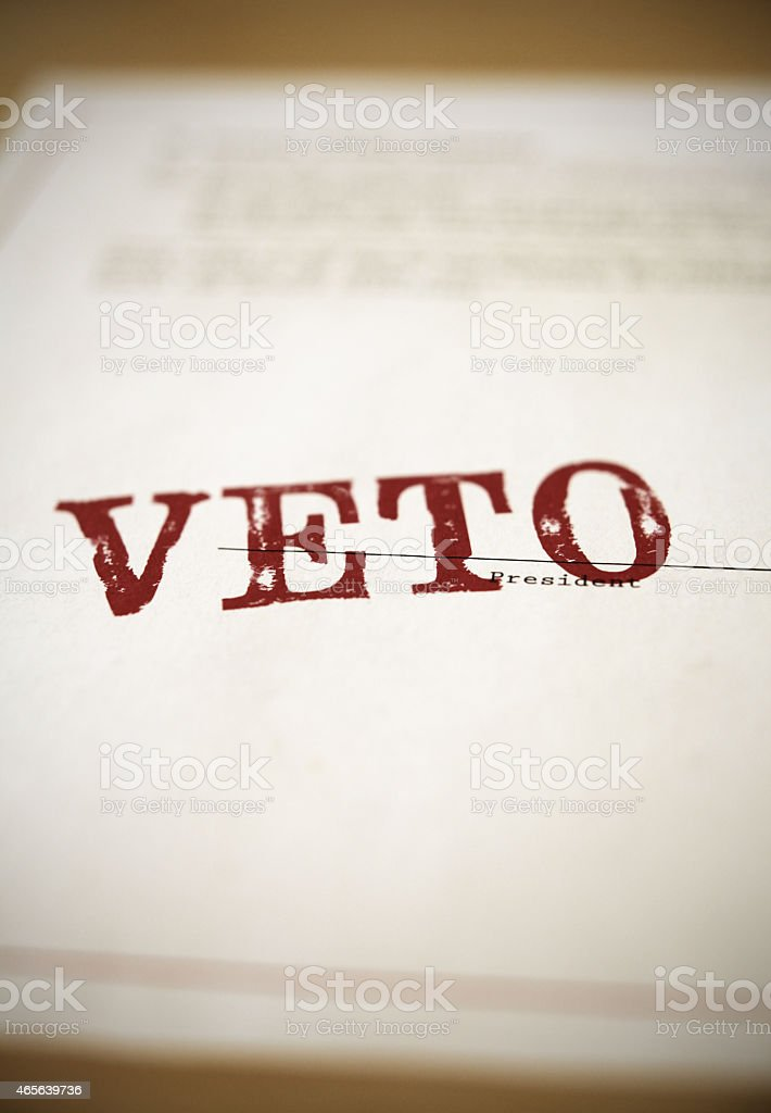Veto stamped across a congressional bill or proposal stock photo