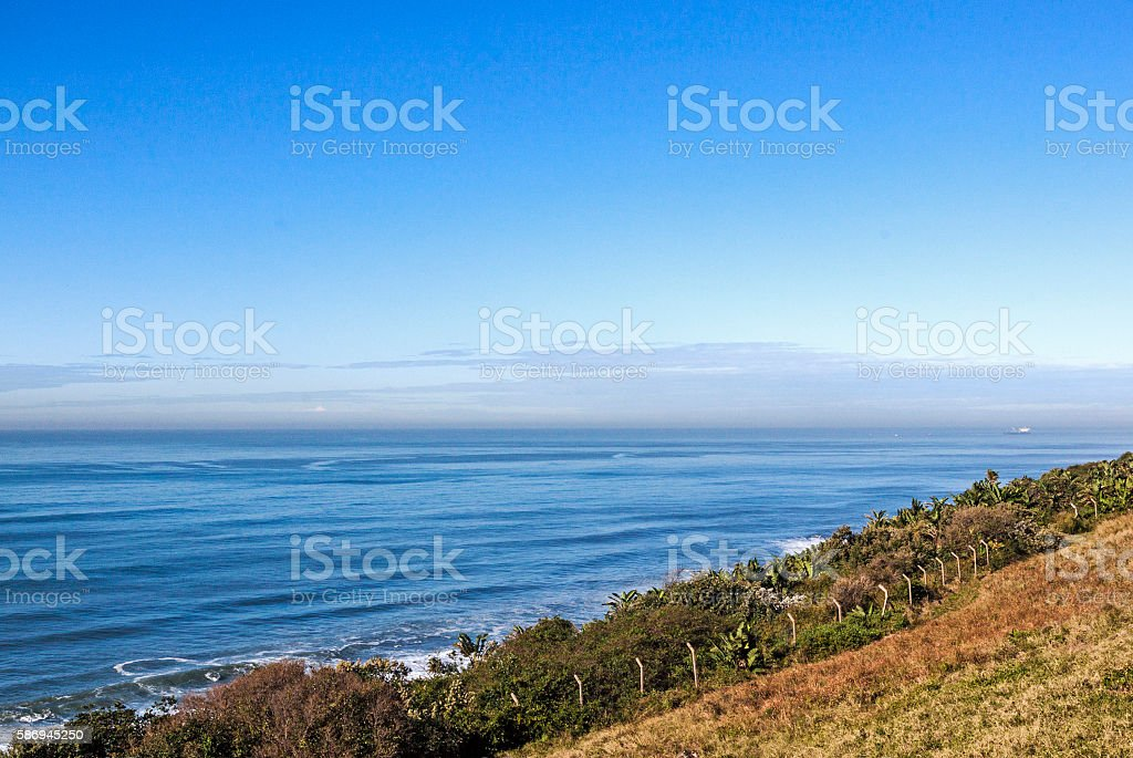 Vgetation and Distand Bcean and blue Coastal Skyline stock photo