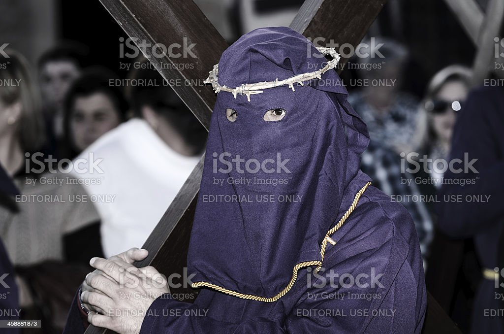 Via Crucis accompanied by penitents with crosses on his shoulder. stock photo