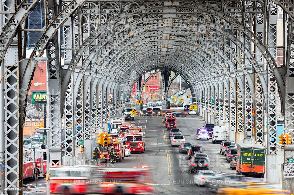 Viaduct in Harlem and Fire Trucks in Action, New York stock photo