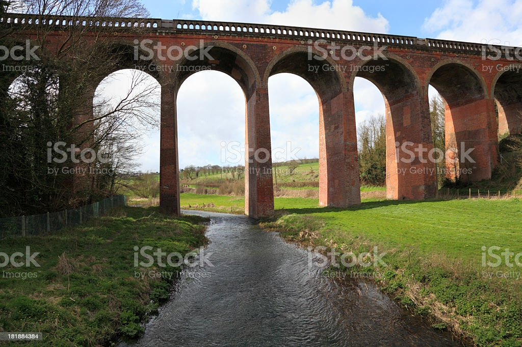 viaduct in typical english scene with river bridge stock photo