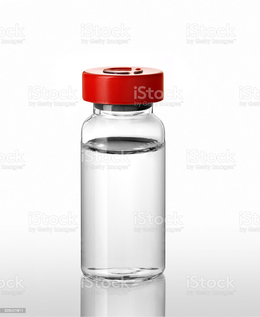 vial of flu vaccine stock photo