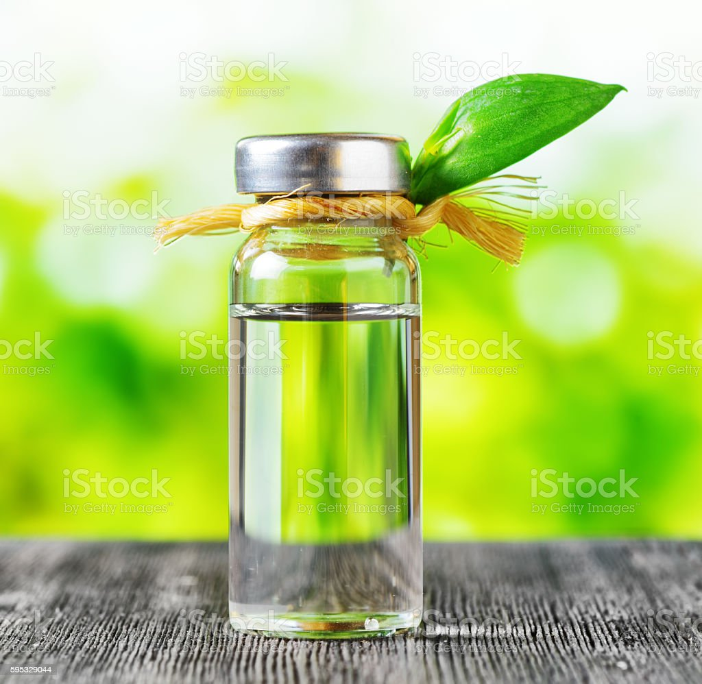 Vial of liquid on nature background stock photo