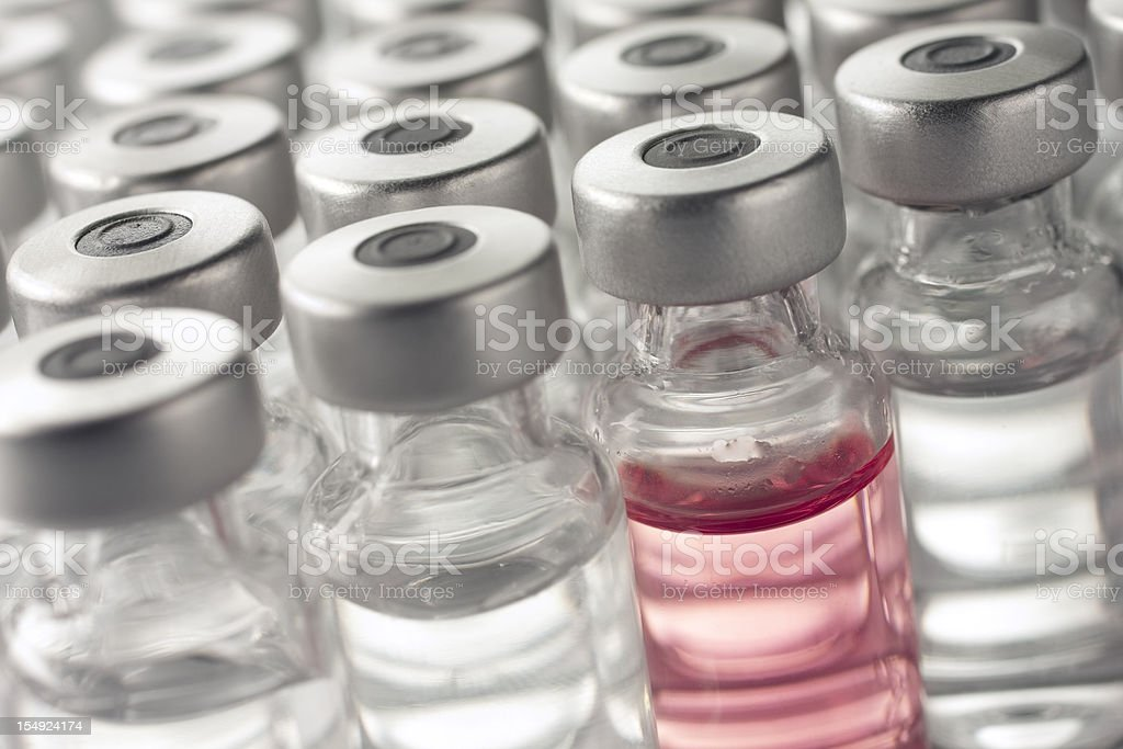 Vial of pink medicine or vaccine stock photo