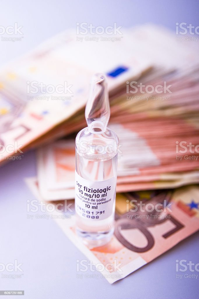 Vial placed on money stock photo