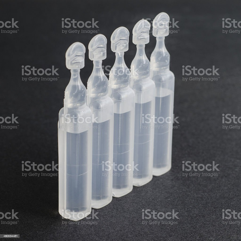 Vials containing physiological serum stock photo