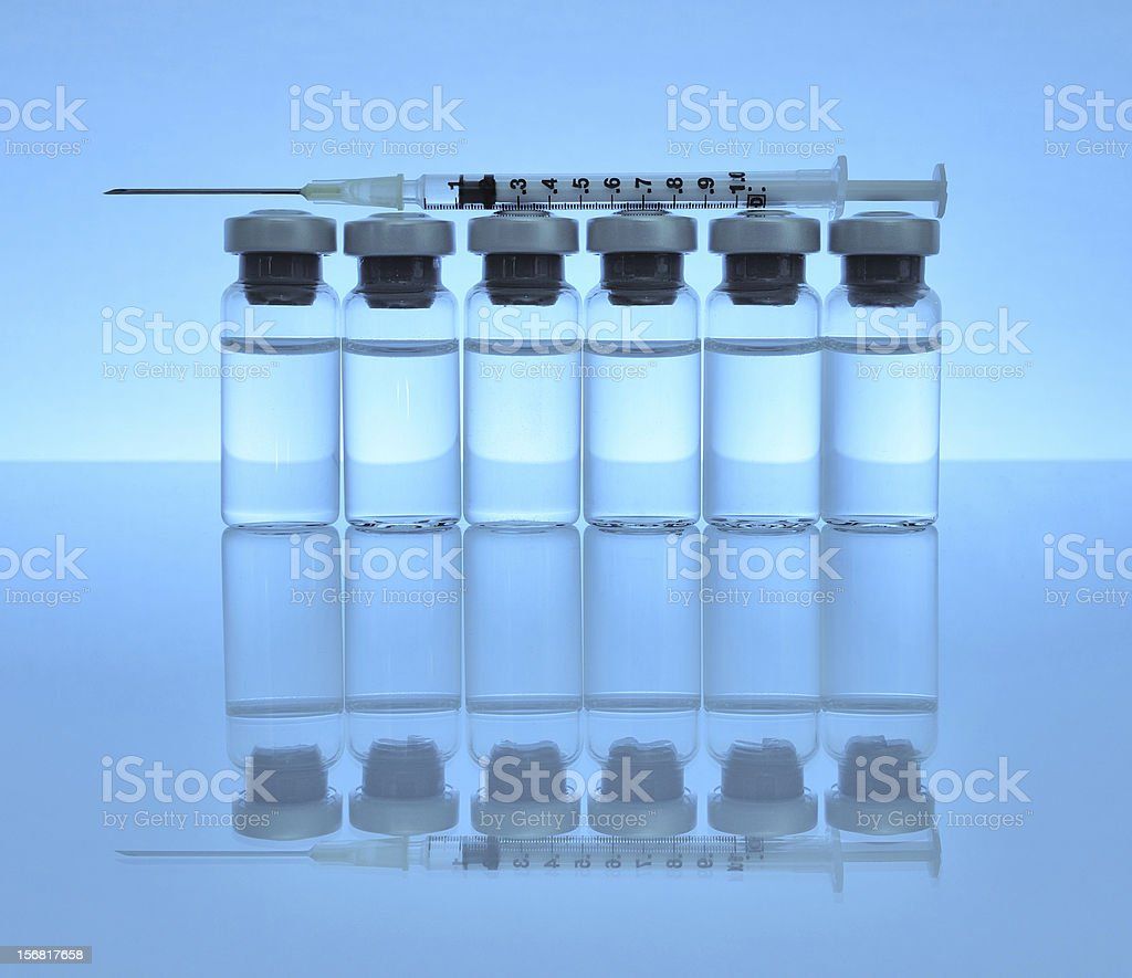 Vials of medications with syringe and needle. royalty-free stock photo