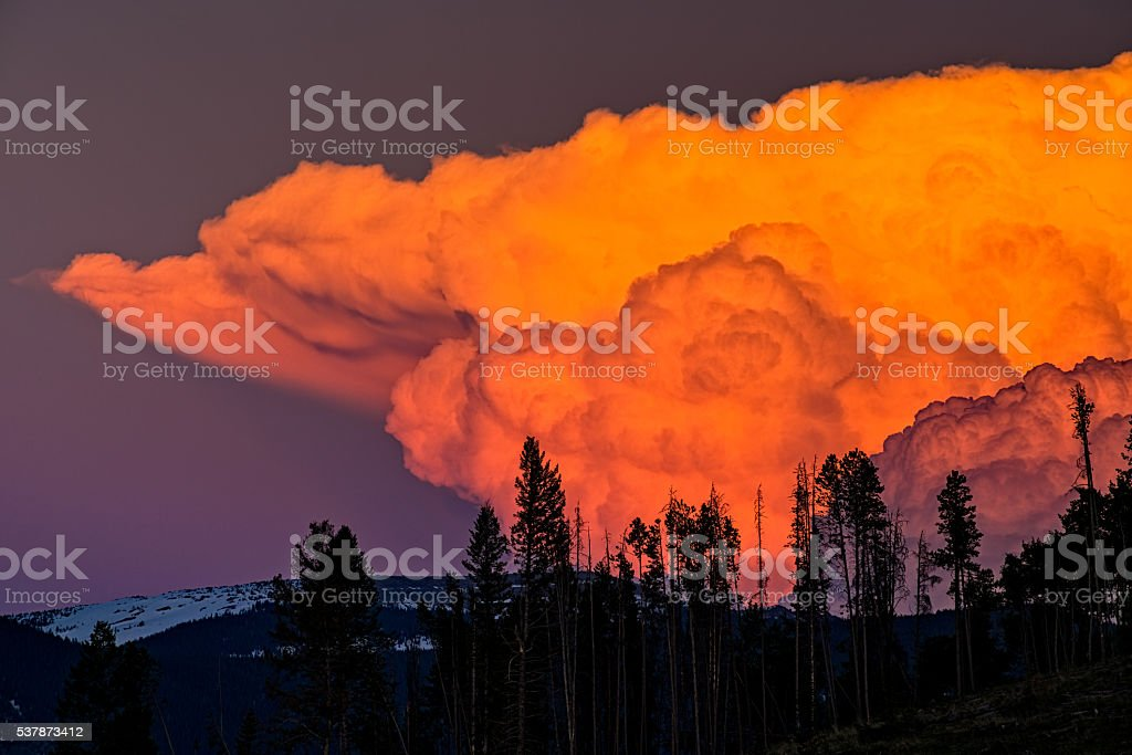 Vibrant Alpenglow on Rising Cumulous Cloud stock photo