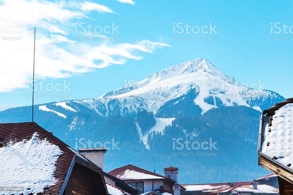 Vibrant Bansko travel ski background with slopes area, snow mountain stock photo