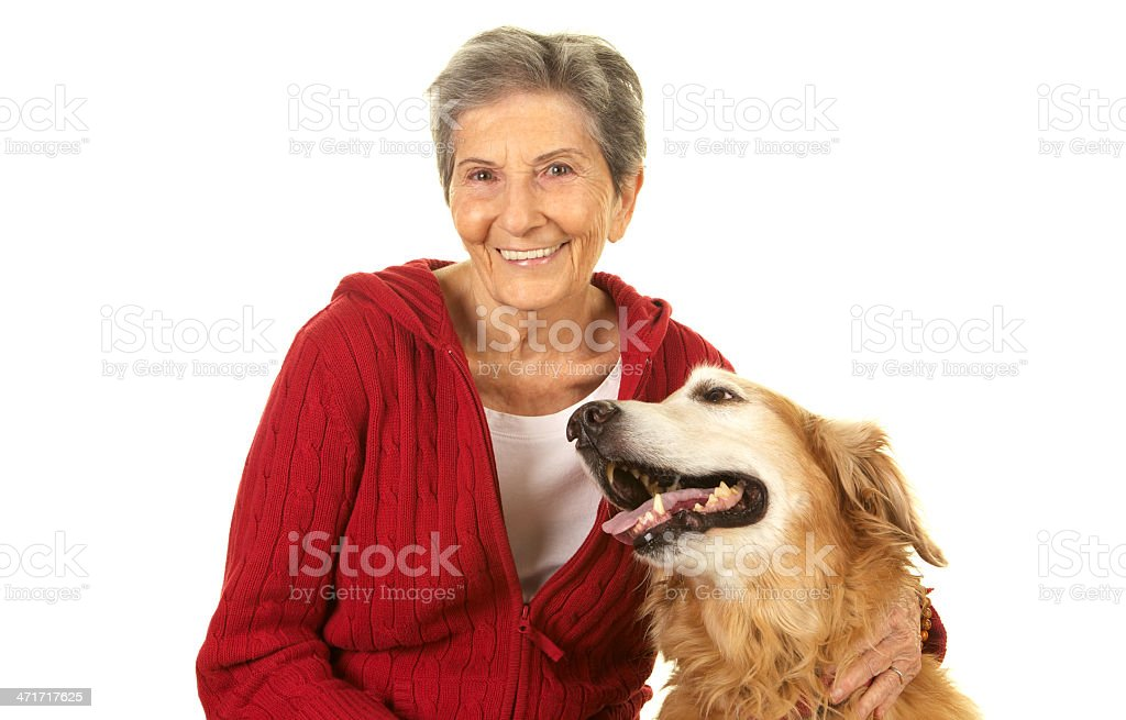 Vibrant Beautiful Senior Woman Smiling With A Golden Retriever Dog royalty-free stock photo