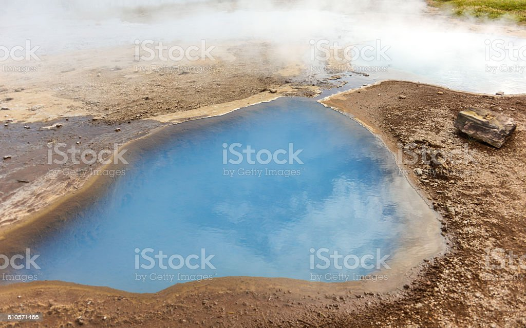 vibrant blue water on small water pond in iceland stock photo