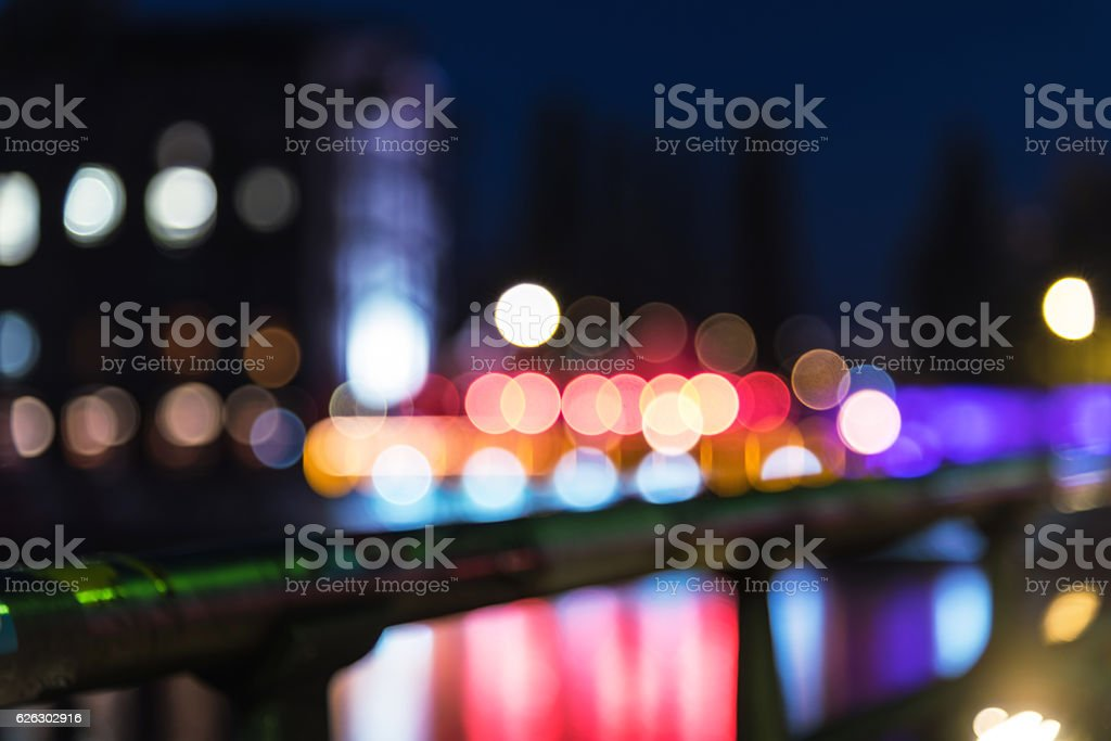 vibrant blurred city lights of berlin reflected in river stock photo