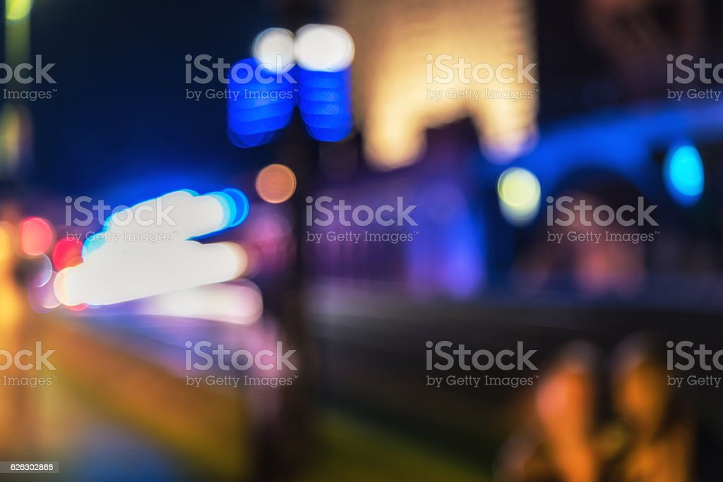 vibrant blurred city night lights of berlin stock photo