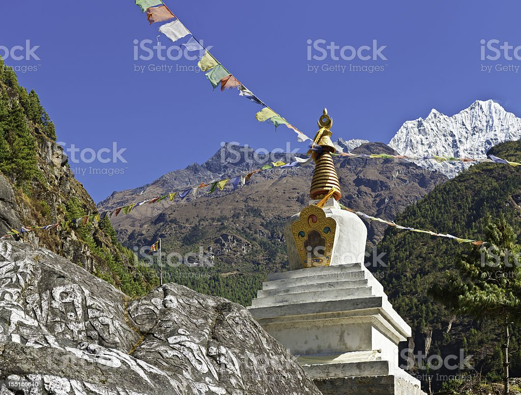 Vibrant Buddhist prayer flags Himalaya peaks royalty-free stock photo