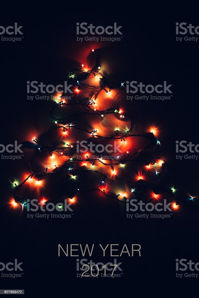 Vibrant Christmas Lights Form a Tree with text stock photo