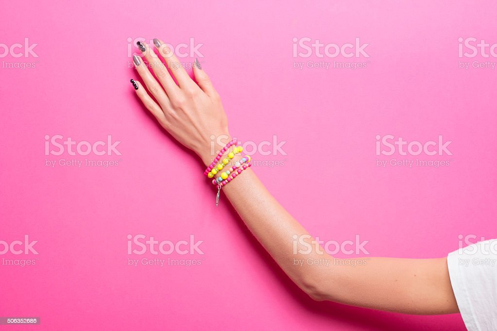 Vibrant Color, one hand hand, wearing jewelry. stock photo