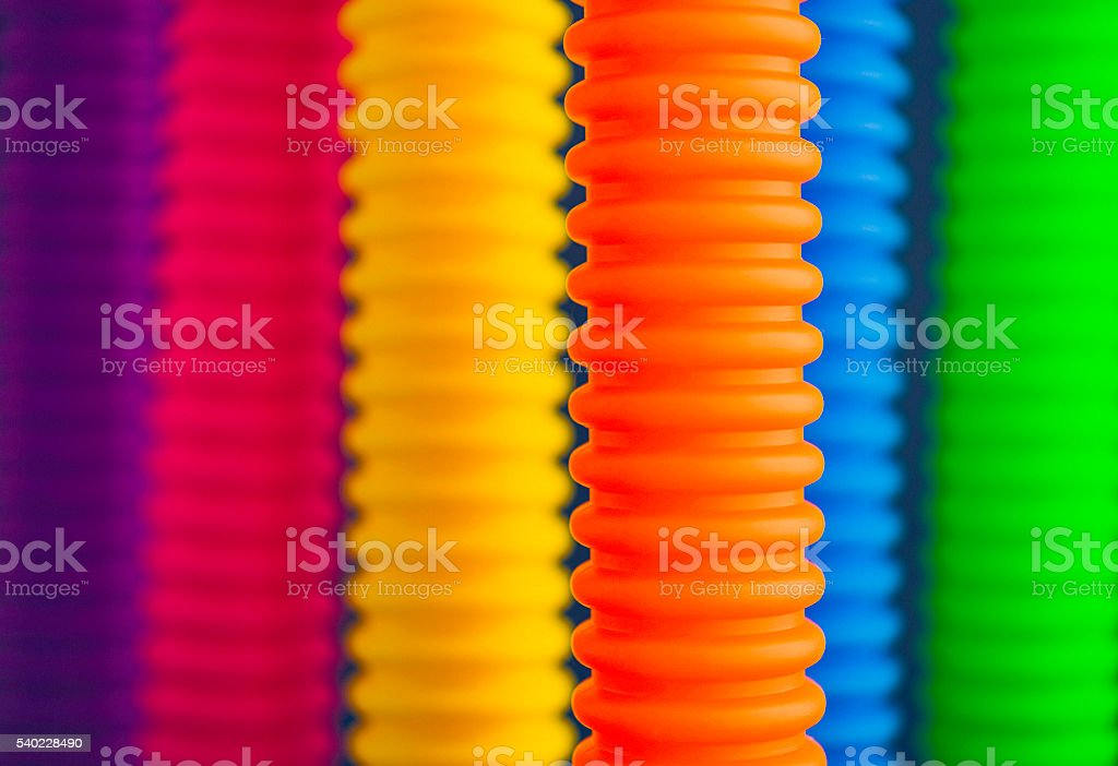 Vibrant colored tubes in primary colors stock photo