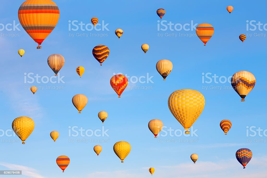 Vibrant colorful air balloons in blue sky. stock photo