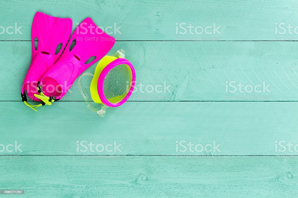 Vibrant colorful kids goggles and flippers stock photo