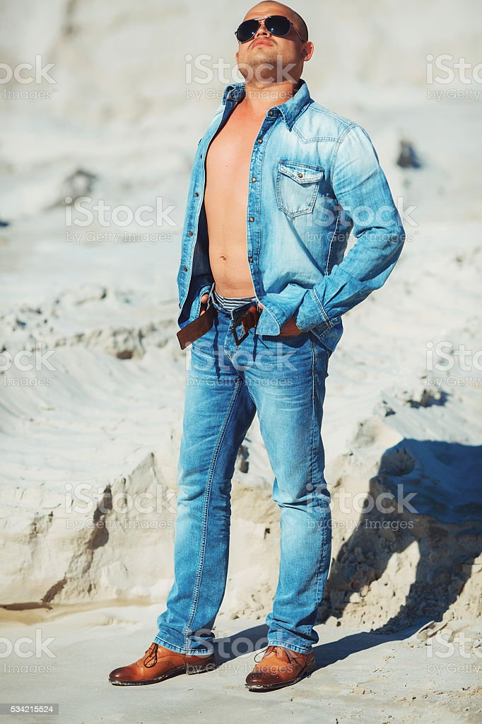 Vibrant fashion portrait of a sexy muscular fit man royalty-free stock photo