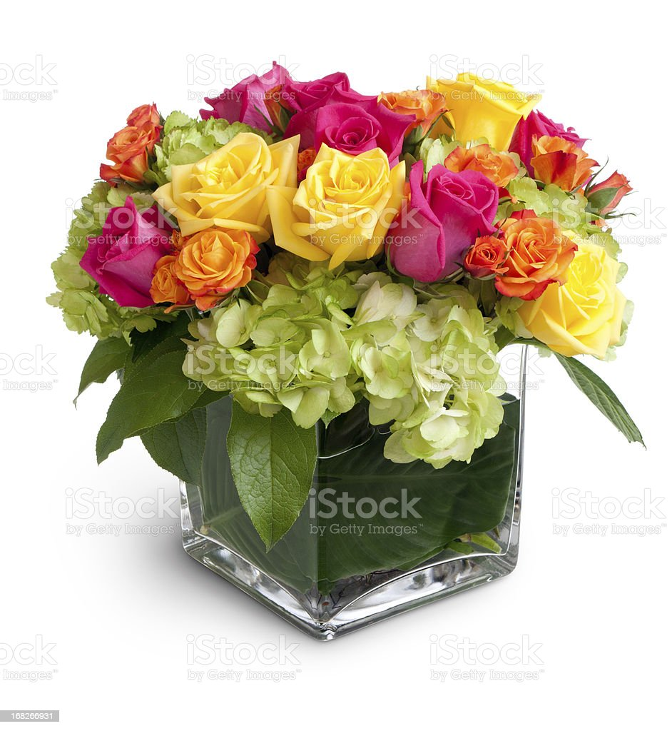 Vibrant Floral Arrangement in Square Crystal Vase Isolated stock photo