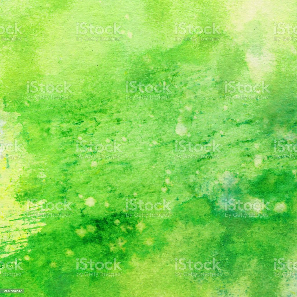 Vibrant green hand painted textured on paper stock photo