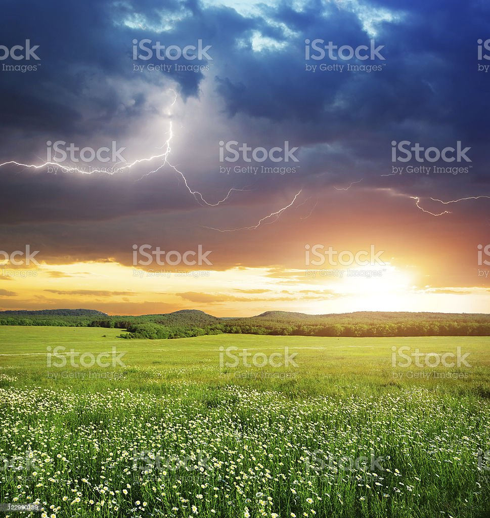 A vibrant green meadow on a mountain in a lightening storm royalty-free stock photo