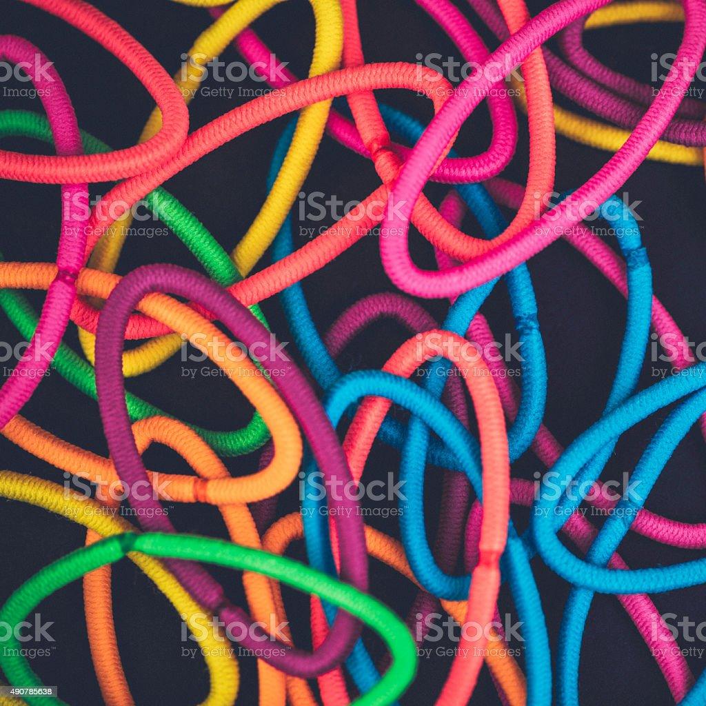 Vibrant hair elastic ties on black background stock photo