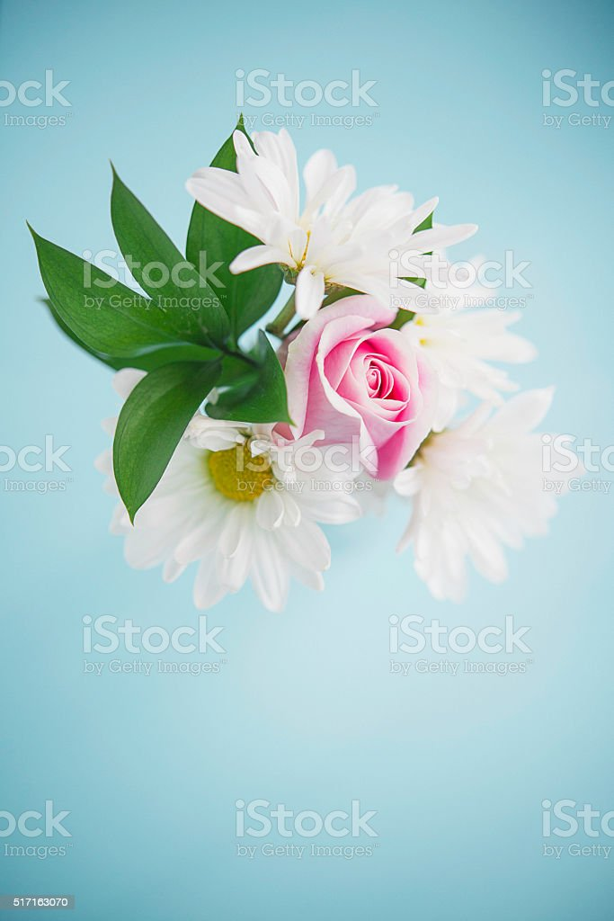 Vibrant Mother's Day bouquet with roses and white dahlias stock photo