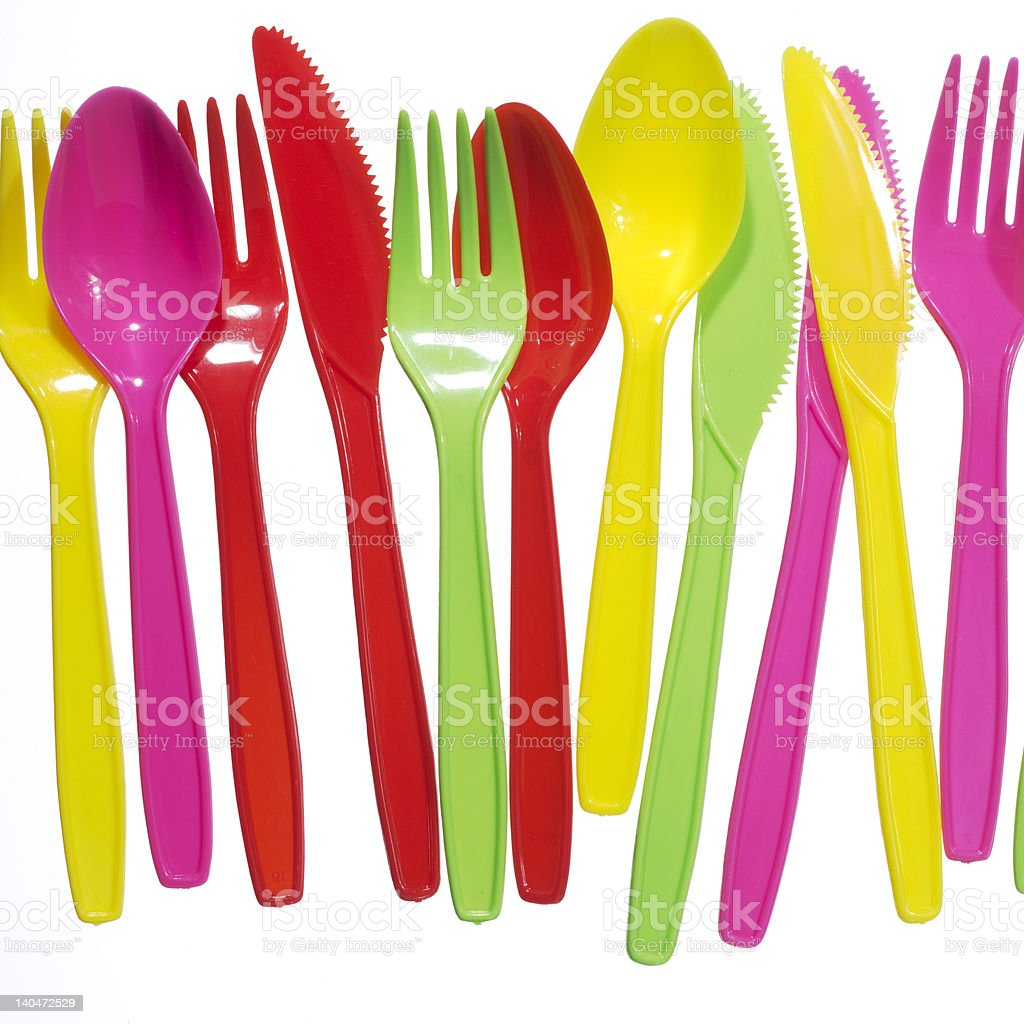 vibrant multicolored forks, kives and spoons stock photo