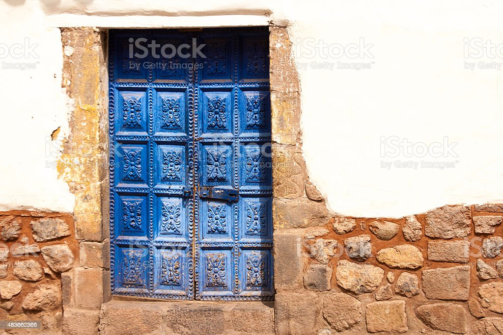 Vibrant Old Carved Blue Door, White Wall, Cusco, Peru stock photo