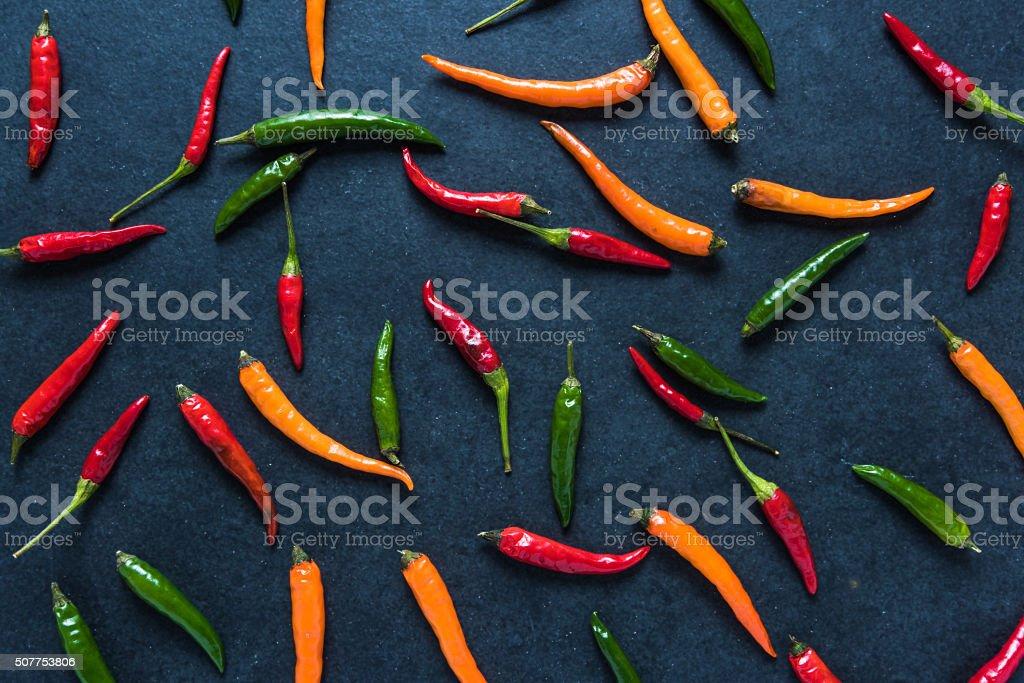 Vibrant peppers on dark slate stock photo