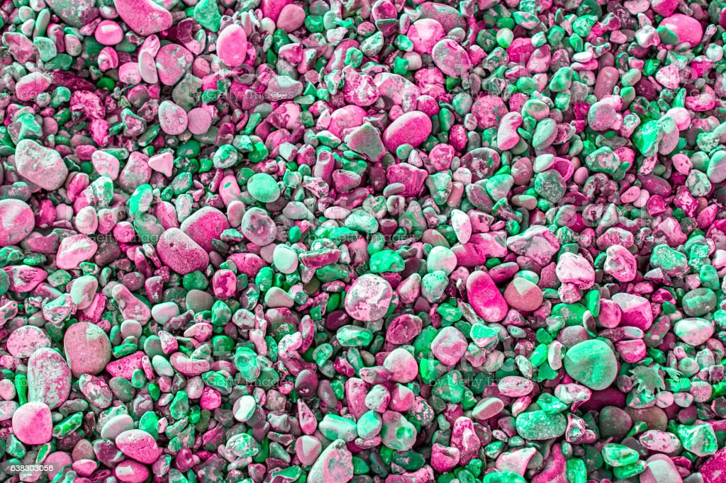 Vibrant pink and green pebbles stock photo