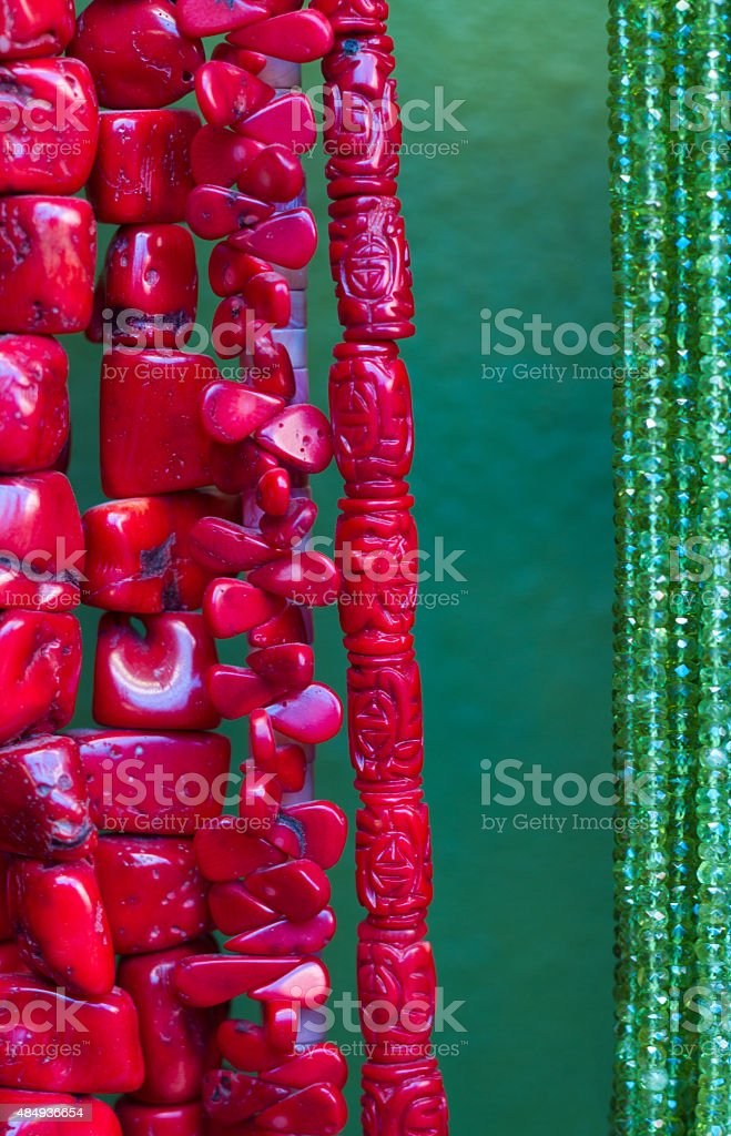 Vibrant Red Turquoise and Green Beads Hanging in Shop (Close-Up) stock photo