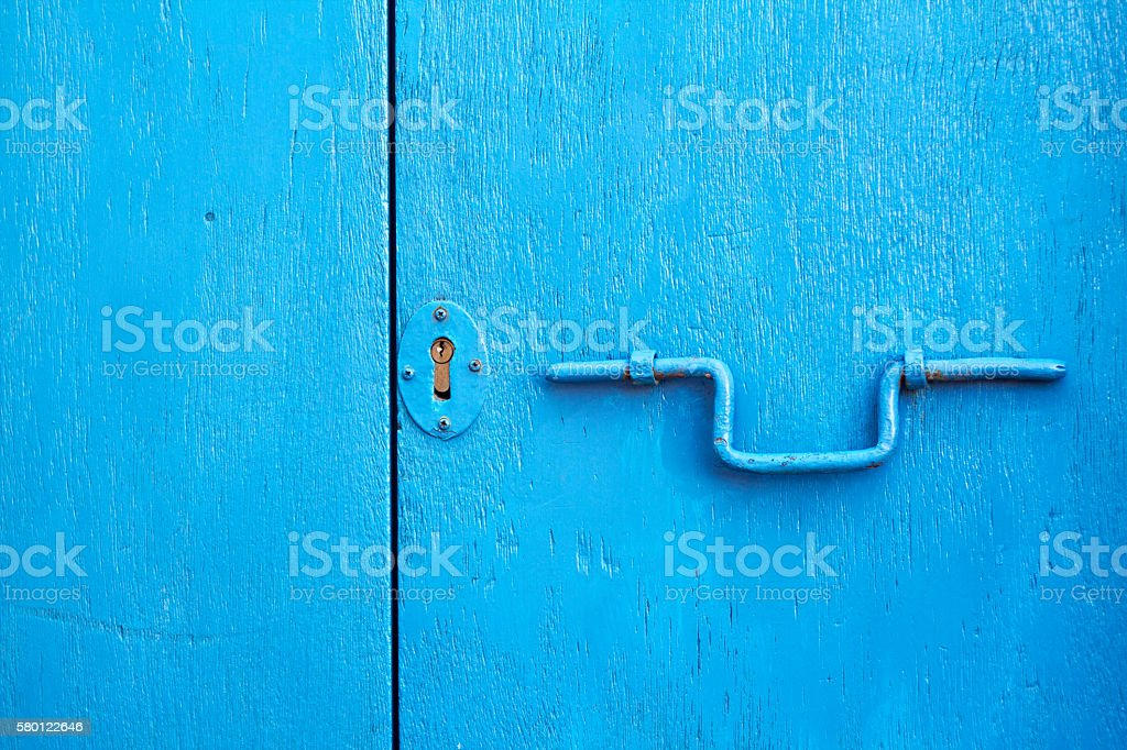 Vibrant Rustic Blue Doors with Old-Fashioned Lock stock photo