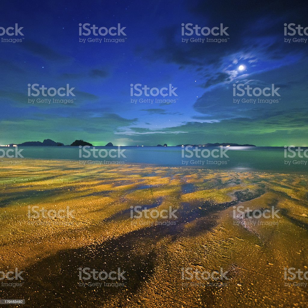 Vibrant starry night above beautiful tropical beach royalty-free stock photo