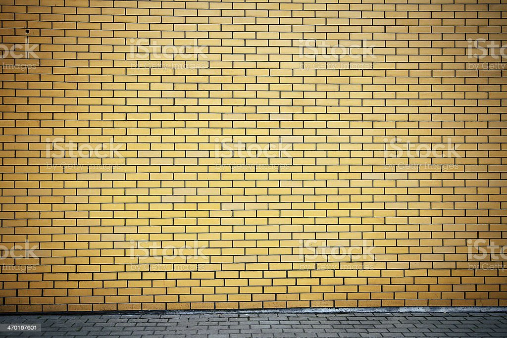 Vibrant yellow brick wall royalty-free stock photo