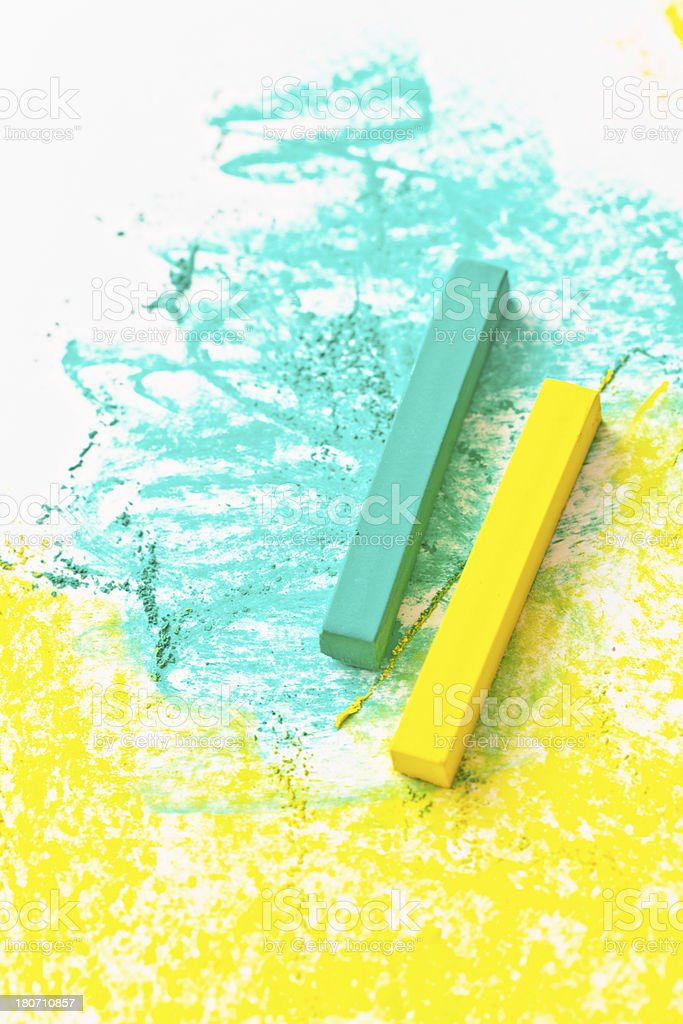 Vibrantly colored turquoise and yellow pastels draw on white sketchpad royalty-free stock photo