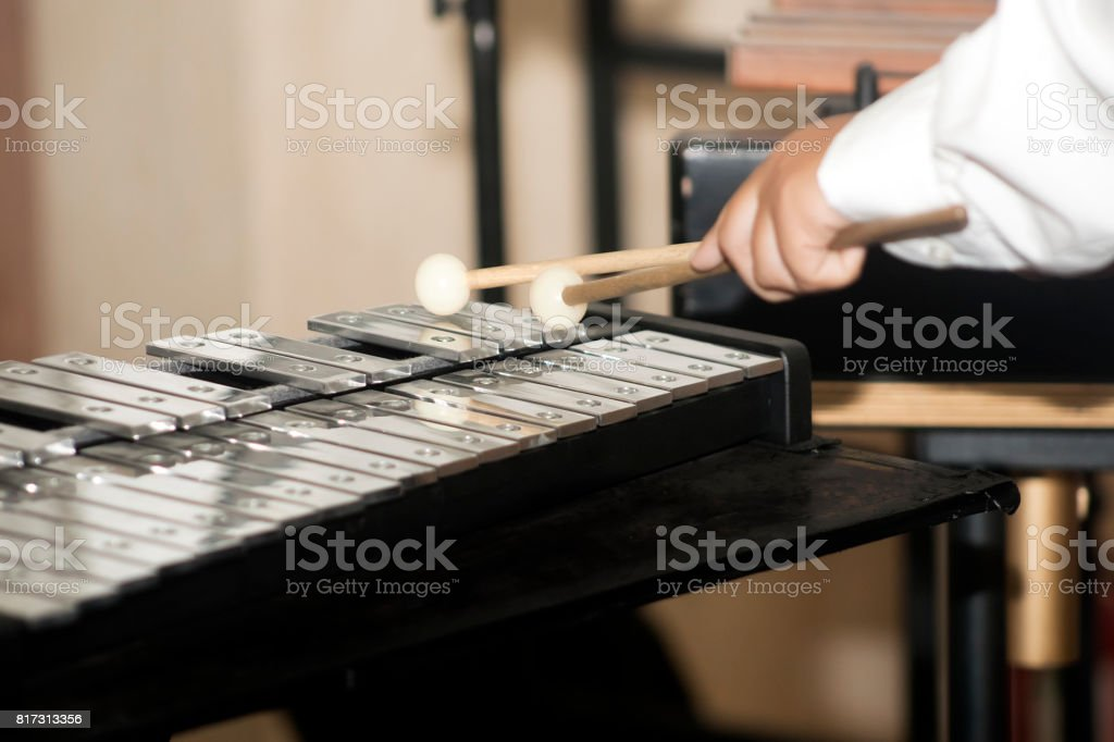 Vibraphone keyboard, musician's hands with drumsticks . stock photo