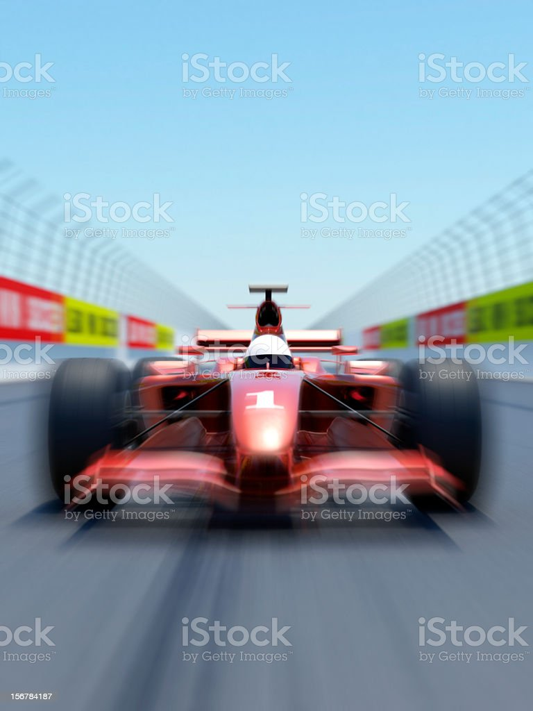 Close front view of a red race car on a track with zoom blur. High...