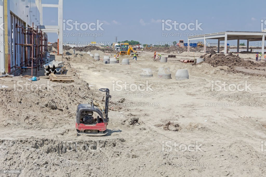 Vibration plate compactor machine is standing at building site. stock photo