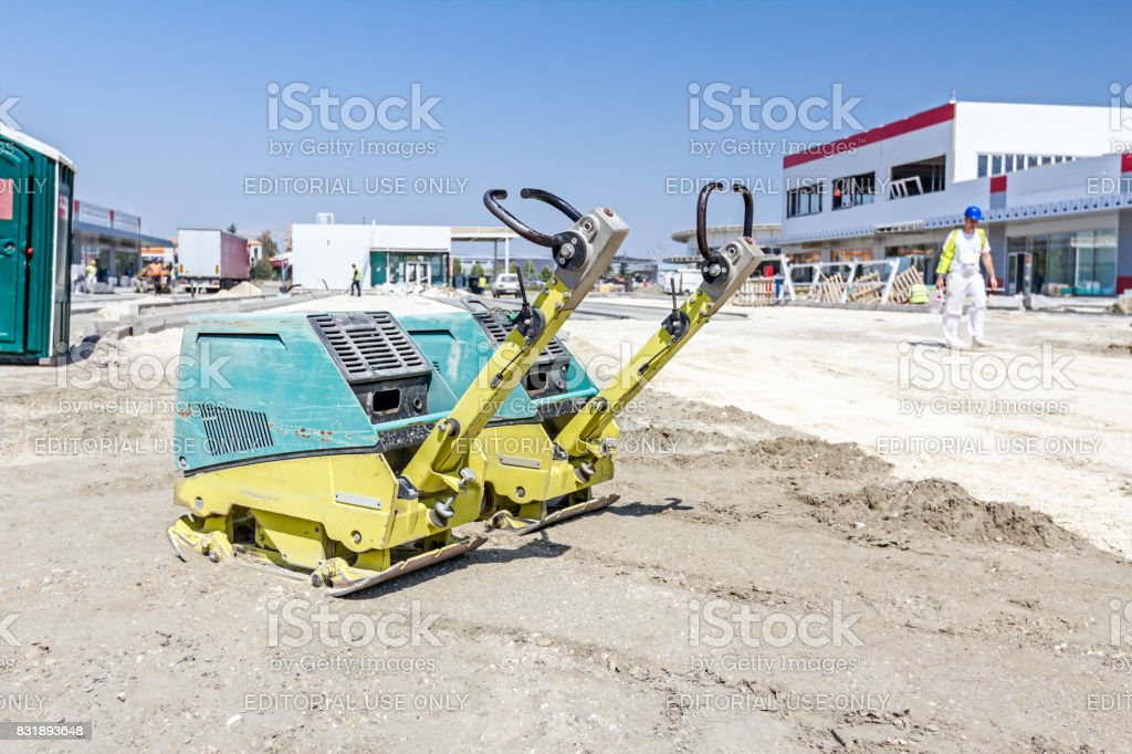 Vibration plate compactor machine is standing at building site stock photo
