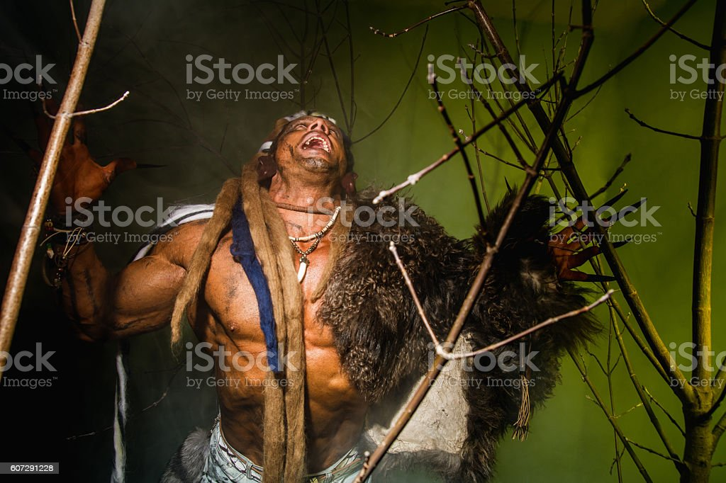 Vicious werewolf with a skin on his shoulder and long stock photo