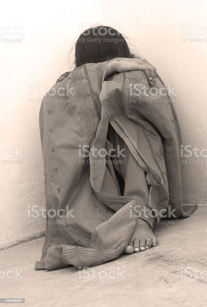 Victim cowering and a corner photo in deli tones royalty-free stock photo