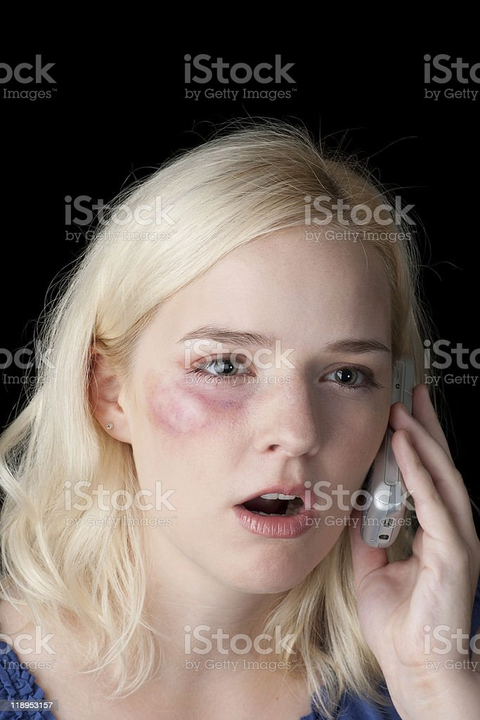 Victim of domestic abuse calling for help royalty-free stock photo