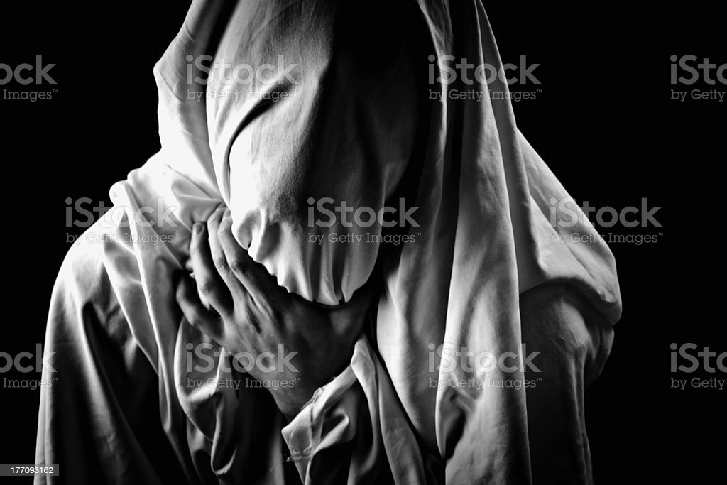 victim with his face covered stock photo